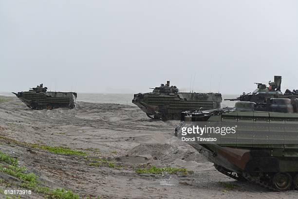 US marines amphibious assault vehicles land on a beach during military exercises with their Philippine marine counterparts on October 7 2016 in...