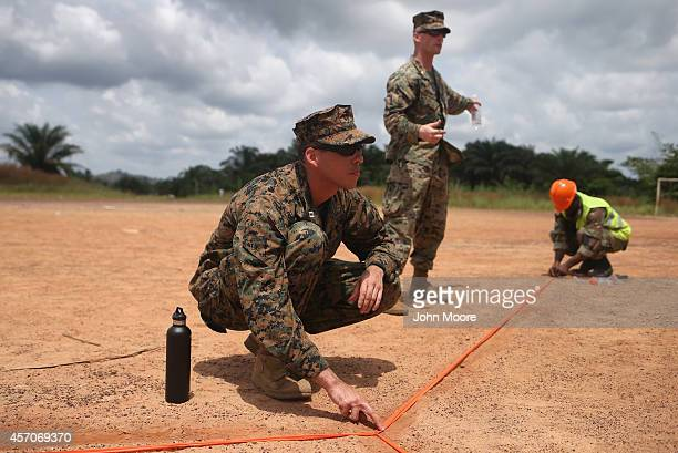 S Marines and Liberian troops set up a landing zone at the construction site of an Ebola treatment center on October 11 2014 in Tubmanburg Liberia...