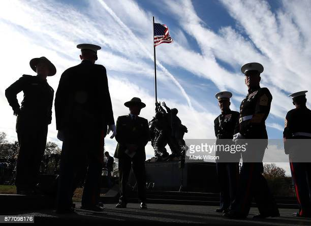 Marines and National Park Service employees gather at the newly restored Iwo Jima US Marine Corps War Memorial on November 21 2017 in Arlington...