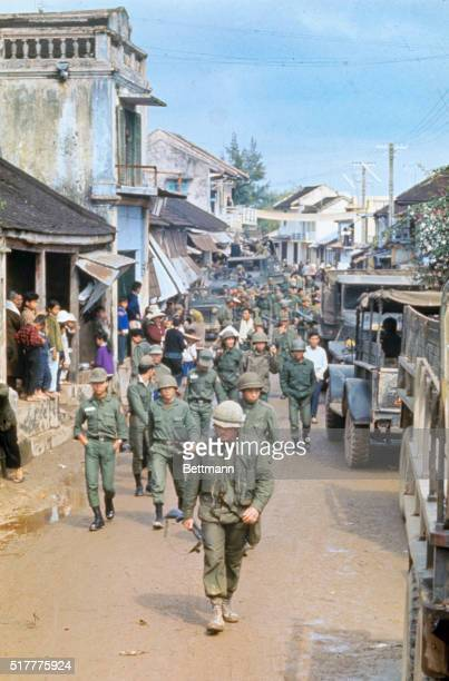 Marines and South Vietnamese troopers on street with refugees soon to be evacuated.