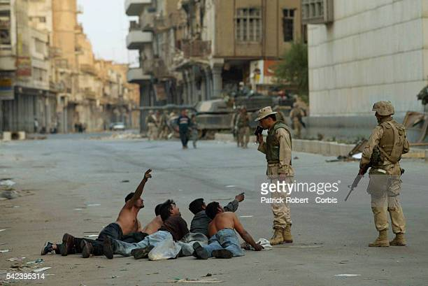 US Marines are posted in the center of old Baghdad to maintain security in an area that has suffered from looters An Iraqi Marine interpreter kicked...