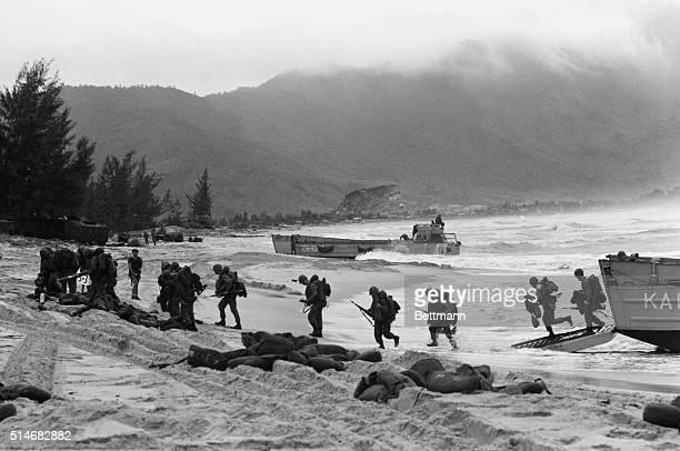 Marines arrive by landing craft at Da Nang where US forces will be stationed to allow Vietnamese troops to mobilize against Vietcong guerrillas.