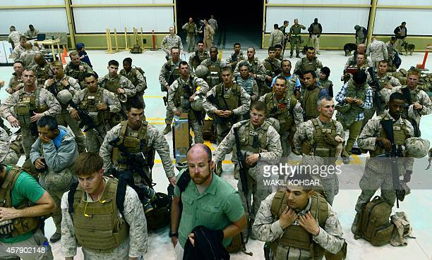 US Marines arrive in Kandahar after their withdrawl from the Camp BastionLeatherneck complex in Helmand province on October 26 2014 British forces on...