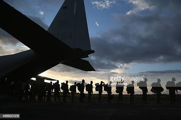 S Marines arrive to take part in Operation United Assistance on October 9 2014 near Monrovia Liberia Some 90 Marines arrived on KC130 transport...