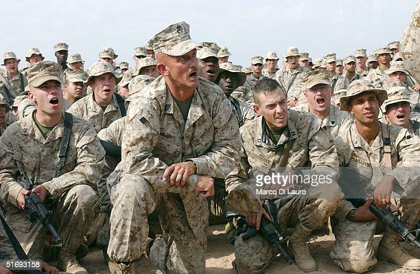 Marines attend the speech of the Commanding General of the US Marines 1st Expeditionary Force Lt Gen John F Sattler anticipating the final offensive...