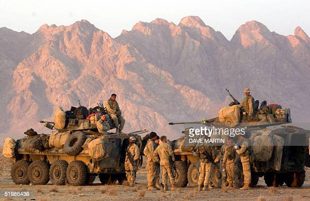 S Marines begin to form up their convoy at a staging area near Kandahar Afghanistan as they await orders to begin their trek to Kandahar to take...