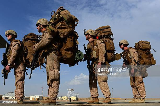 US Marines board a C130J Super Hercules transport aircraft headed to Kandahar as British and US forces withdraw from the Camp BastionLeatherneck...