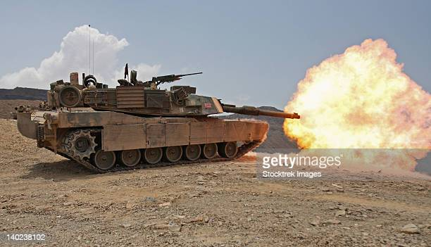 marines bombard through a live fire range using m1a1 abrams tanks. - m1 abrams stock pictures, royalty-free photos & images