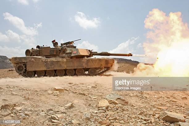 marines bombard through a live fire range using m1a1 abrams tanks. - armored tank stock photos and pictures