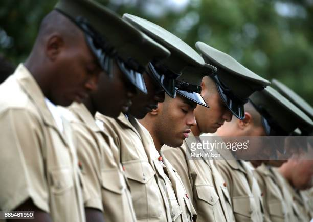 S Marines bow their heads during a ceremony to commemorate the anniversary of the 1983 bombing of the Marine barracks in Beirut Lebanon at the Marine...