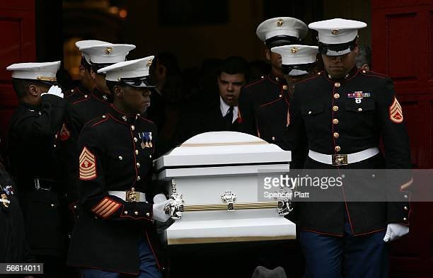 S Marines carry body of Nixzmary Brown out to a hearse after her funeral January 18 2006 in New York City Brown was found beaten to death last week...