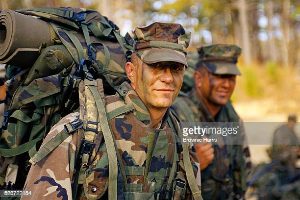 marines carrying gear - us marine corps stock pictures, royalty-free photos & images