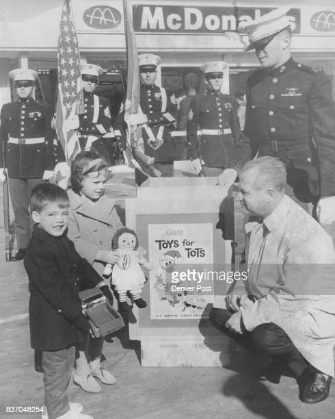 Marines Collect Toys for Tots From left are Stephen McKee his brother Terry sons of Mr and Mrs Richard McKee of Golden Carl Reed vice president of...