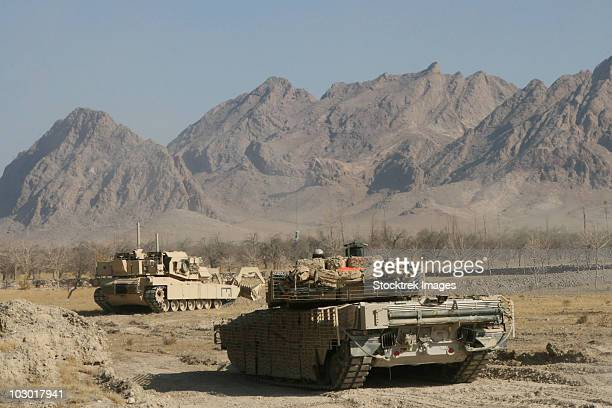 Marines conduct combat operations in Now Zad, Afghanistan, during Operation Cobra's Anger.