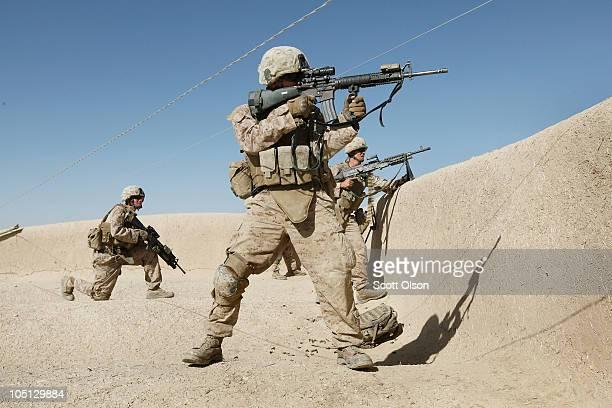 S Marines Cpl Dave Needham of Fruita Colorado LCpl Caleb Bailey of Fort Walton Beach Florida and Pfc Logan Harty of Dixon California attached to...