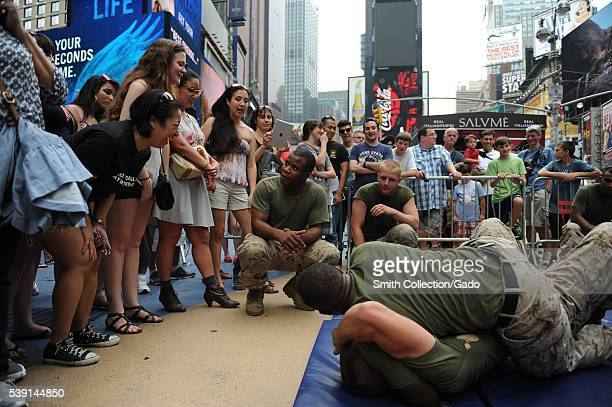 Marines demonstrate grappling techniques to onlookers in Time Square during Fleet Week New York 2015 Image courtesy Mass Communication Specialist 1st...