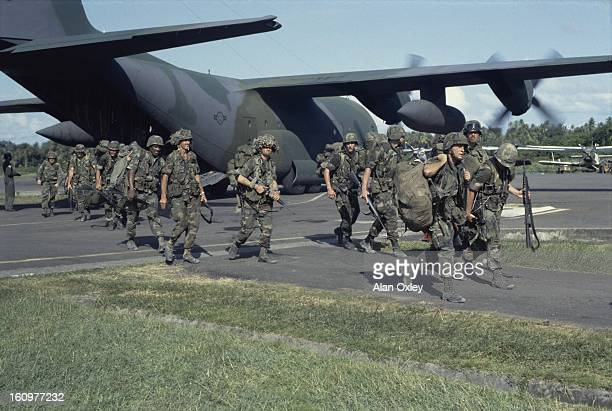 US Marines disembark at an airstrip near Gouyave during the US invasion of Grenada in Oct 1983
