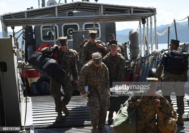 US marines disembark from a Philippine navy landing ship during a simulation of a disaster drill as part of the annual joint PhilippinesUS military...