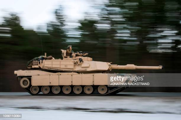 US Marines drive an M1 Abrams to take part in an exercise to capture an airfield as part of the Trident Juncture 2018 a NATOled military exercise on...