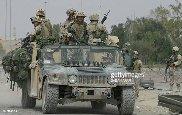US marines drive out from the restive city of Fallujah west of Baghdad 29 April 2004 Marines will start to leave 30 April Fallujah's southern...