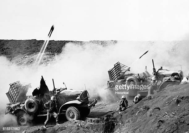 Marines employ mobile rocket units against Japanese forces on Iwo Jima during the Battle of Iwo Jima.