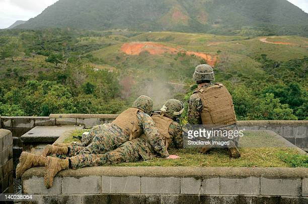 marines engage unknown-distance targets at camp schwab, japan. - us marine corps stock pictures, royalty-free photos & images