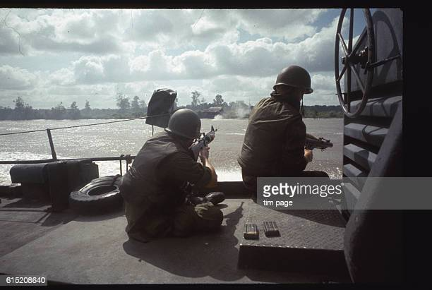 Marines fire on a coastal village from an American Navy swift boat on the Ca Mao River | Location Ca Mao River Vietnam
