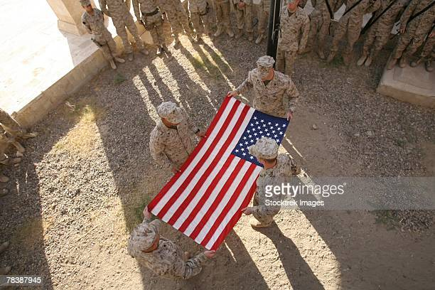 marines fold an american flag. - ceremony stock pictures, royalty-free photos & images