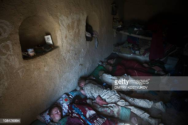 US Marines from 1st Battalion 8th Bravo company rest in a compound not far from Shir Chazay in Musa Qala district of Helmand province on January 22...