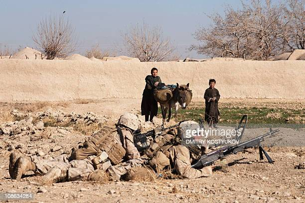 US Marines from 1st Battalion 8th Bravo look on during an operation in Zalmabad village in Musa Qala district of Helmand province on January 23 2011...