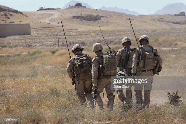 Marines from 1st squad 2nd platoon with India Battery, 3rd Battalion, 12th Marine Regiment carry the remains of Cpl. Jorge Villarreal of San Antonio,...