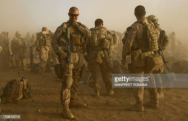 US Marines from 2nd Battalion 8 Marine Regiment of 2nd Marine Expeditionary Brigade wait to board helicopters as they leave to take part in Operation...