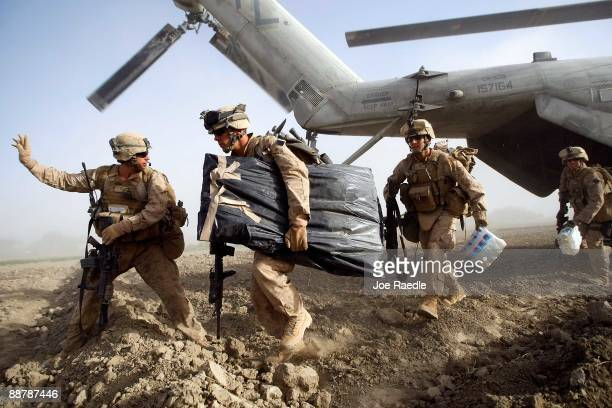 S Marines from 2nd Marine Expeditionary Brigade RCT 2nd Battalion 8th Marines Echo Co run off the back of a helicopter during the start of Operation...