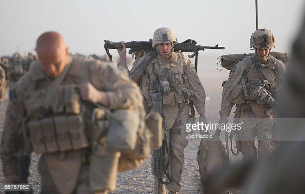 S Marines from 2nd Marine Expeditionary Brigade RCT 2nd Battalion 8th Marines Echo Cowalk to their helicopter during the start of Operation Khanjari...