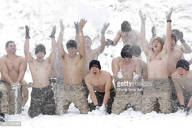 S Marines from 3rd Marine Expeditionary force deployed from Okinawa Japan cover themselves in snow with South Korean marines during a winter military...