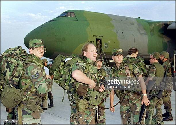 Marines from California arrive 27 November 1991 at Saudi Dhahran air base. Iraq's invasion of Kuwait 02 August 1990, ostensibly over violations of...