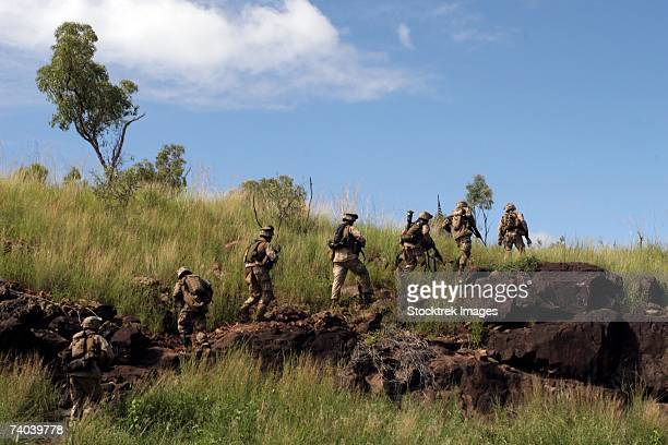marines from co. c, battalion landing team 1st battalion, 4th marine regiment, camp pendleton, california, patrol the rugged australian outback near townsville, march 17 during a four-day training exercise that began march 13. - army stock pictures, royalty-free photos & images