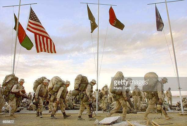 S Marines from India company march with their gear as they prepare to depart the American military compound at Kandahar Airport January 22 2002 in...