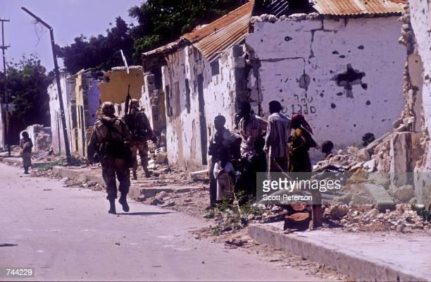Marines from Kilo Company patrol along Mogadishu's Green Line January 10, 1993 in Mogadishu, Somalia. The Green line divides rival clan factions who...