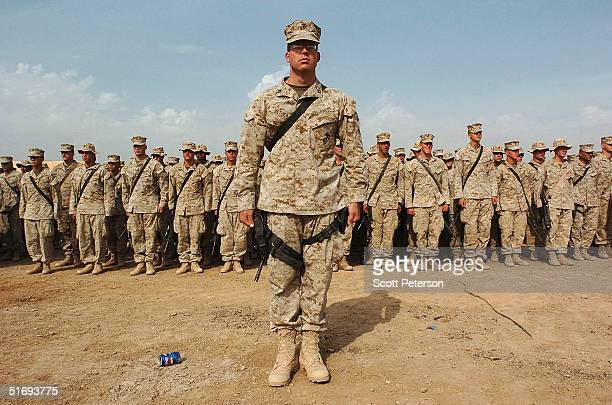 S Marines from Regimental Combat Team 7 stand at attention to hear top generals make final rally speeches before an expected assault on Fallujah...