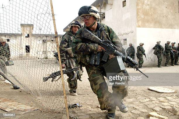 Marines from Task Force Tarawa attack the military garrison of the Iraqi 23 Infantry brigade March 24, 2003 in the southern Iraqi city of Nasiriyah....