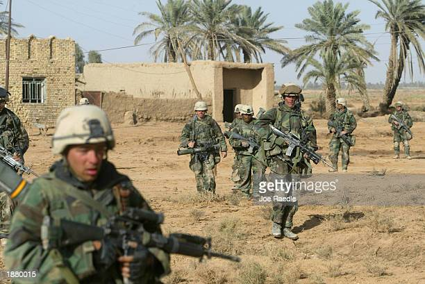 Marines from Task Force Tarawa clear a small village March 27, 2003 in the southern Iraqi city of Nasiriyah. As Operation Iraqi Freedom enters its...
