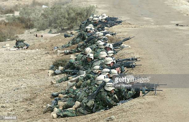 Marines from Task Force Tarawa do battle with Iraqi troops March 24, 2003 in the southern Iraqi city of Nasiriyah. The Marines have had running gun...