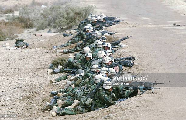 Marines from Task Force Tarawa do battle with Iraqi troops March 24, 2003 in the southern Iraqi city of Nasiriyah. 1/2 Charlie Company returned home...