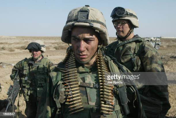 Marines from Task Force Tarawa keep a weary eye out after they saw a day of intense fighting March 23, 2003 in the southern Iraqi city of Nasiriyah....