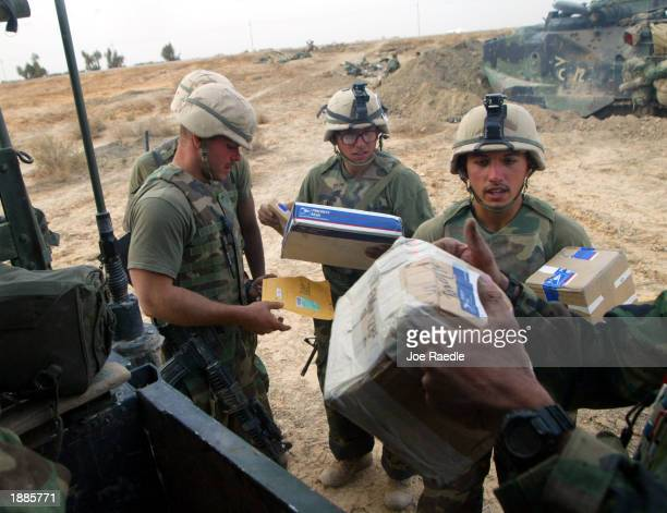 Marines from Task Force Tarawa receive a mail delivery at the battle stations March 30, 2003 in the southern Iraqi city of Nasiriyah. The Marines...