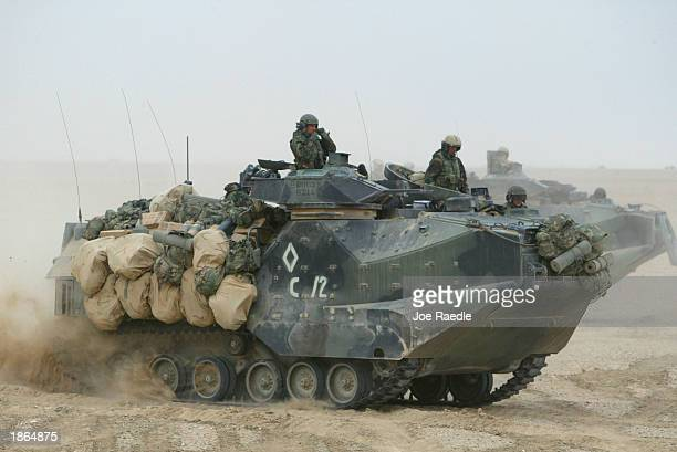S Marines from Task Force Tarawa roll through the Iraqi countryside in their armored assault vehicles March 22 2003 on their way to an objective in...