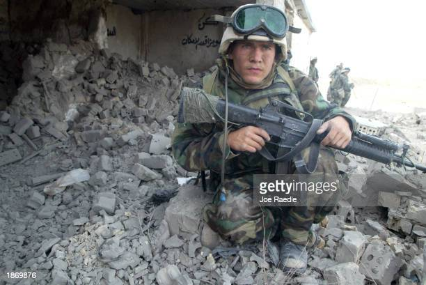 S Marines from Task Force Tarawa sweep through the military garrison of the Iraqi 23 Infantry brigade March 25 2003 in the southern Iraqi city of...