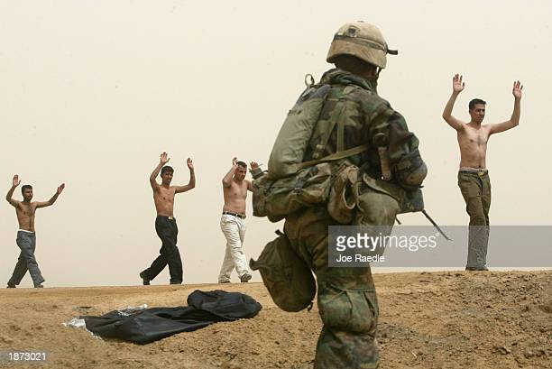 S Marines from Task Force Tarawa take in surrendering Iraqis March 26 2003 in the southern Iraqi city of Nasiriyah Most who turned themselves in were...