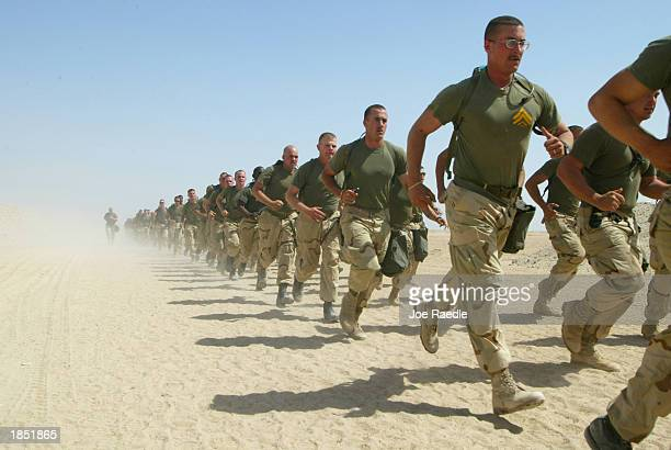 S Marines from Task Force Tarawa take part in a 25 mile run March 16 2003 at Camp Shoup near the Iraqi border in Kuwait The Marines continue to...